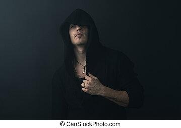 man in  black robe calm - man in a black robe calm