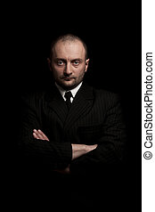 man in black suite  - Man in black suite whit arms crossed
