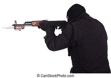 man in black uniform and mask with AK 47 gun