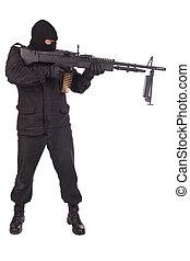 man in black uniforms with machine gun