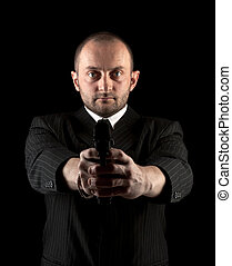 man in black with gun