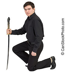 Man in black with the japanese sword in a hand