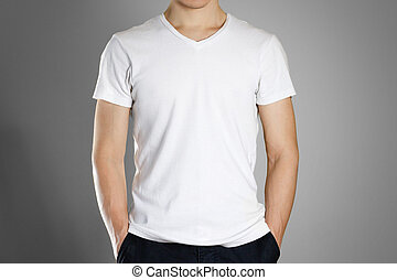 Man in blank white t-shirt. Front. Ready for your design. Hands in his pockets. Closeup. Isolated