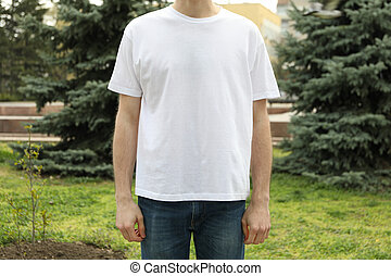 Man in blank white t-shirt. Outdoor photo