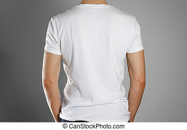 Man in blank white t-shirt. Rear. Ready for your design. Hands in his pockets. Closeup. Isolated