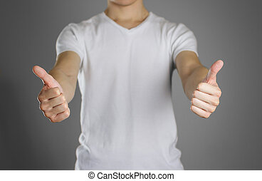 Man in blank white t-shirt shows thumb up. Isolated