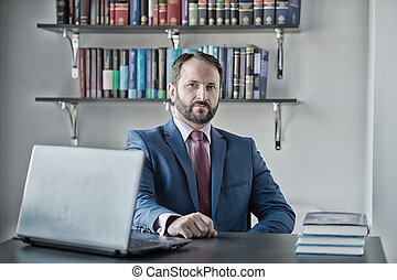Man in blue formal suit at office workplace