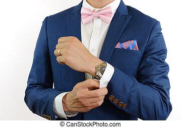 man in blue suit bowtie, pocket square