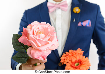 man in blue suit carry flowers