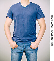 Man in blue t-shirt. Grey background.