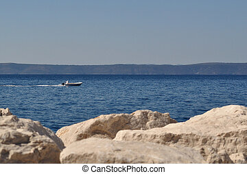Man in boat on the sea