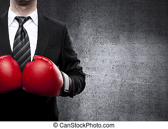 man in boxing gloves - businessman in boxing gloves on...