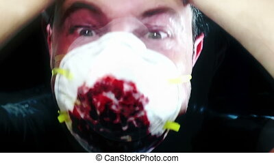 Horror clip man in breathing mask with flashes of horrific images