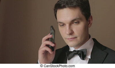 man in business clothes with phone