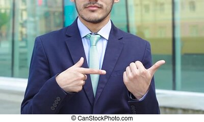 Man in business suit show gesture To the right standing...