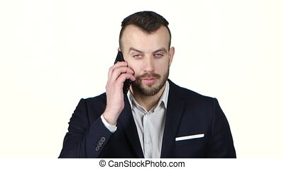 Man in business suit talking on mobile phone. White background