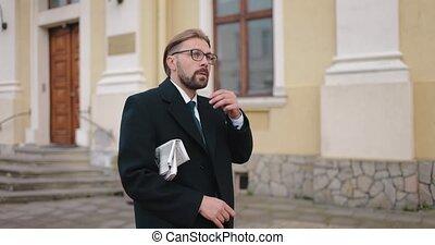 Man in business suit walking on street