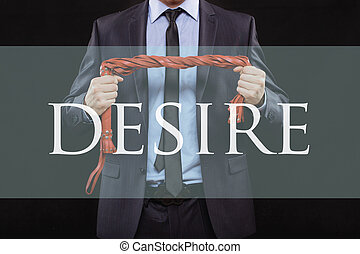 man in business suit with chained hands. handcuffs for sex games. concept of erotic entertainment. desire