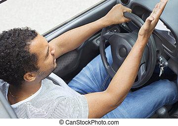 Man in car annoyed by traffic