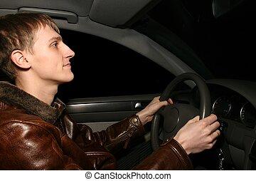man in car at night