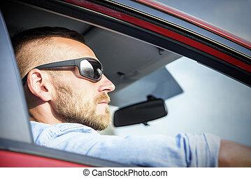 Man in car.