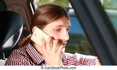 Man in car talking on phone