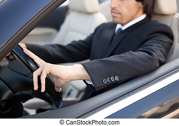 Man in car - Young man in luxury sports car