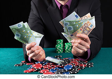 Man in casino wins heap of money - Elegant man in casino...
