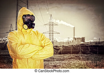 Man in chemical protective suit over factory