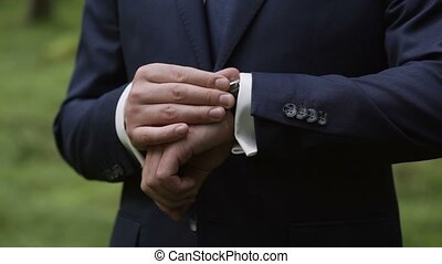 Man in classical suit look at wrist watch - Man in classical...