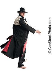 Man in coat gesticulates
