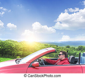 Man in convertible car.