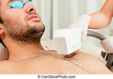 Man in cosmetic salon receiving waxing - Mann receiving...