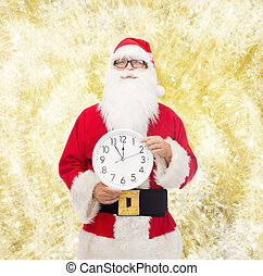 man in costume of santa claus with clock - christmas,...