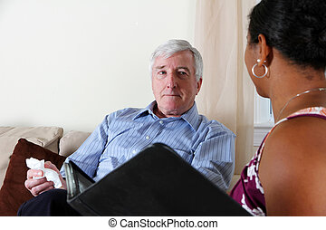 Man in Counseling - Woman Couseling a Man in Her Office
