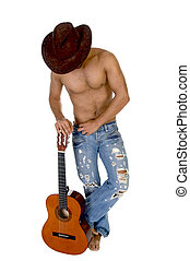 man in cowbow hat holding guitar