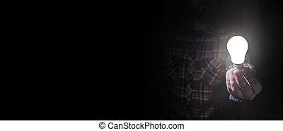 man in dark with glow bulb