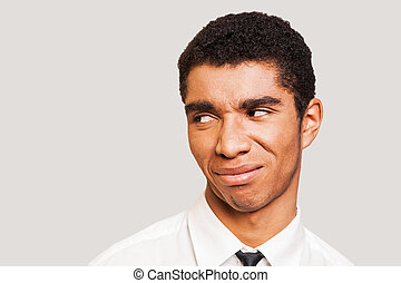 Man in disbelief. Close-up portrait of young Afro-American ...