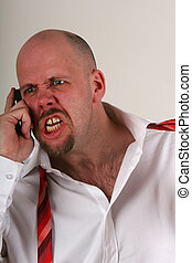 An angry man talking on a mobile phone in shirt and loose tie