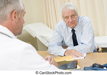 Man in doctor\'s office frowning