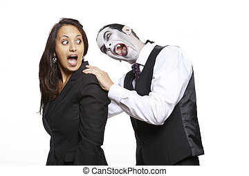 Man in dracula fancy dress costume biting girls neck