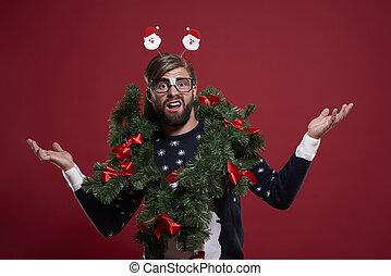 Man in embarrassing Christmas garland