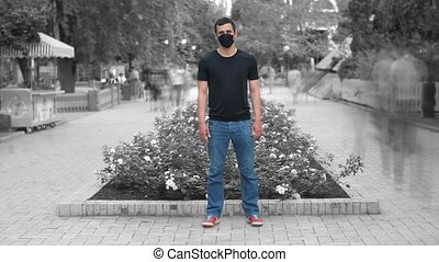 Man in face mask in the crowdy flow