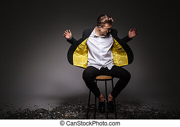 Man in fashion cloth sititng on the chair