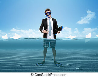 Man in fins and goggles hands folder standing in sea