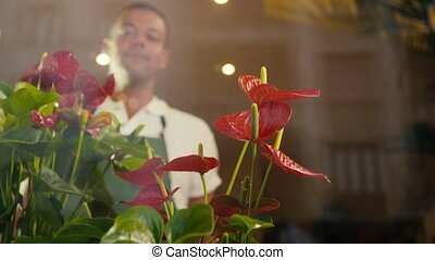 man in flower shop helping customer