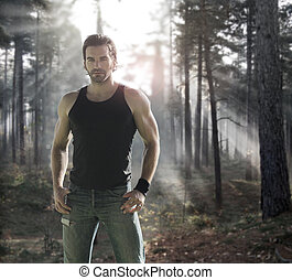 Man in forest - Portrait of a good looking male model in...
