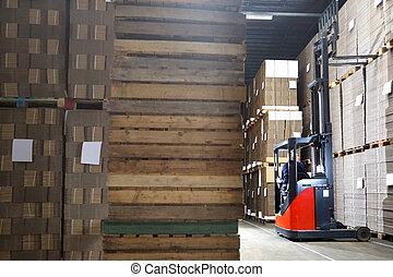 Man In Forklift Examining Stock