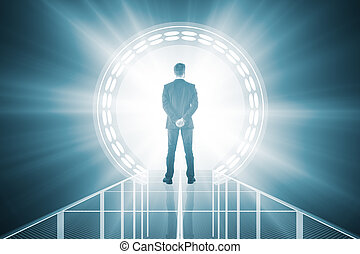 Man in front of blue teleport - Back view of businessman...