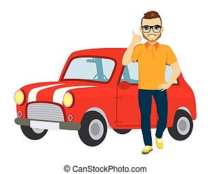Happy young man standing in front of classic red car